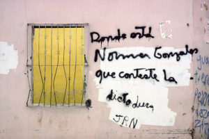 "NICARAGUA. Monimbo. Wall graffiti on Somoza supporter's house burned in Monimbo, asking ""Where is Norman Gonzalez? The dictatorship must answer."" (NICARAGUA, page 15) ©Susan Meiselas/Magnum Photos"