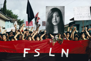 NICARAGUA. Jinotepe. A funeral procession for assassinated student leaders. Demonstrators carry a photograph of Arlen Siu, an FSLN guerrilla fighter killed in the mountains three years earlier.