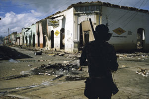 NICARAGUA. Masaya. Muchacho withdrawing from commercial district of Masaya after three days of bombing.